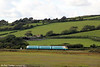 The 1508 Milford Haven to Manchester Piccadilly approaches Kidwelly on 29th August 2011.