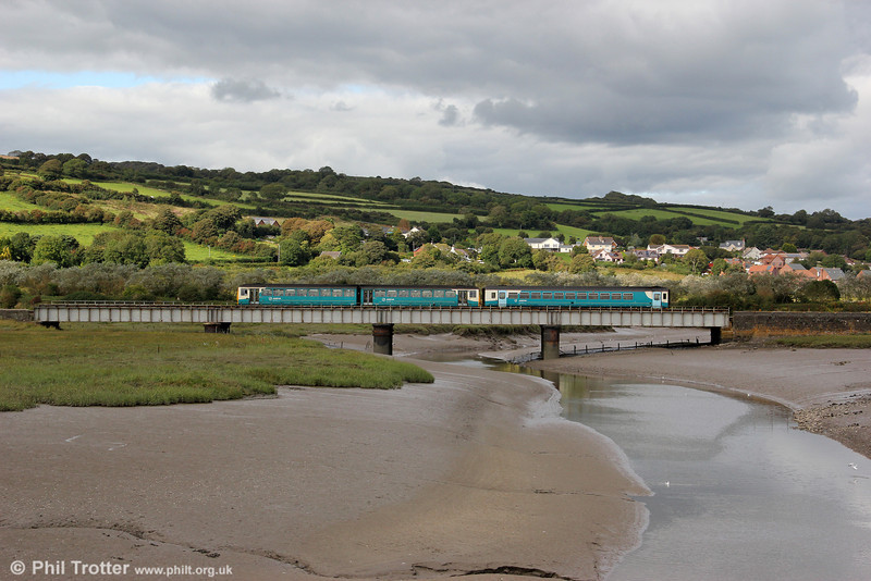 The 1509 Pembroke Dock to Swansea crosses the 92 yard Kidwelly Viaduct over the River Gwendraeth on 29th August 2011,