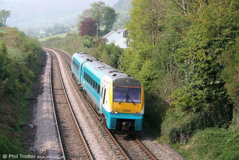 175004 climbs through Penyclawdd forming the 0920 Cardiff Central to Holyhead on 22nd April 2011.