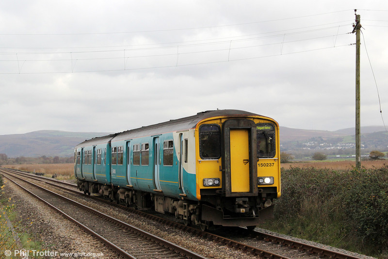 150237 is seen passing Llangennech forming the 1057 Cardif Central to Fishguard Harbour on 24th November 2011.