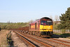 On a perfect spring morning, 60096 is seen near Llangennech with 6B03, 0910 Trostre to Llanwern on 9th April 2011.