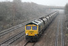 66597 passes Llandevenny in a snowstorm with 6M04, 1050 Portbury to Rugeley Power Station on 3rd January 2011.