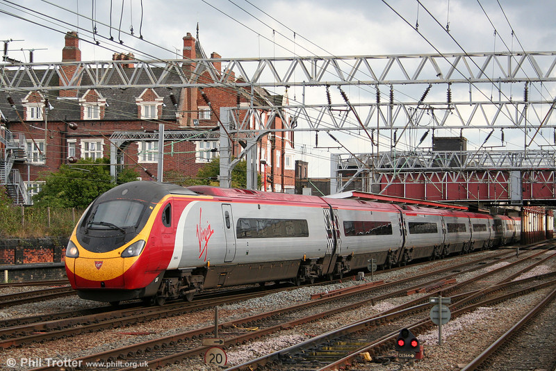 390043 'Virgin Explorer' departs from Crewe forming the 1540 London Euston to Manchester Piccadilly on 2nd August 2011.