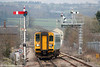 Semaphore country: 153323 crosses over at Craven Arms ready to begin its journey along the Heart of Wales Line forming the 1405 Shrewsbury to Swansea on 12th March 2011.