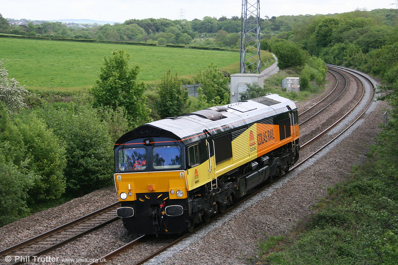 Colas 66841 passes Llangewydd, running light from Llanwern to Margam for the afternoon's 6Z78 to Dollands Moor on 8th May 2011.