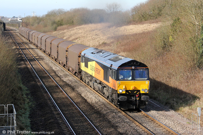 The Sunday morning milk tanker is leaving Stormy Farm as Colas Rail 66846 - the former Freightliner 66573 - climbs Stormy Bank with 6O78, 1100 Margam to Dollands Moor and Sous le Bois on 26th February 2012. The area name 'Stormy' (as in Stormy Down) is not in fact a reflection of prevailing local weather conditions; it is derived from a Norman family named Sturmi that created a settlement known as Sturmiestown in approximately 1150. Now you know...