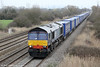 DRS 66302 passes Coedkernew with 4V38, 0822 Daventry to Wentloog 'Tesco Express' on 16th March 2012. 66302 was new to Fastline in 2008, that company going into administration in March 2010.