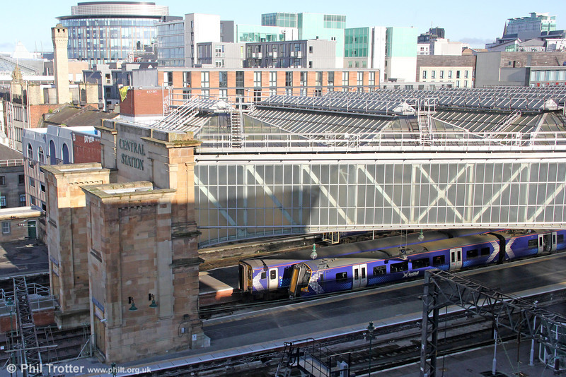 An alternative view of Glasgow Central with 156502 and 380005 at the recently constructed platforms 12 and 13 on 7th August 2012. The new platforms were originally commissioned for the now-shelved Glasgow Airport Rail Link and occupy the space previously used as the station car park.