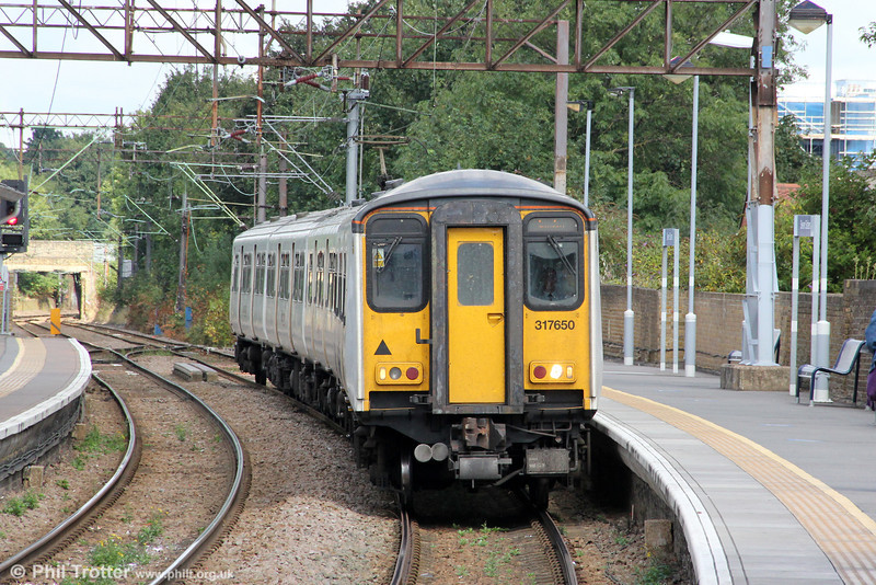 317650 at Seven Sisters forming 2U41, Enfield Town to London Liverpool Street on 26th August 2012.