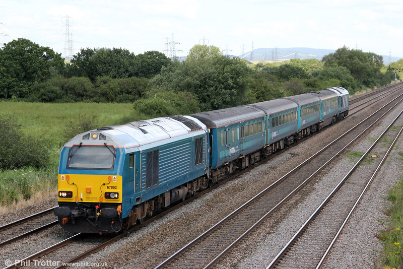 67003 passes Coedkernew with 1V41, 0805 Holyhead to Cardiff Central 'Olympic Extra' on 28th July 2012. Classmate 67001 was at the rear.