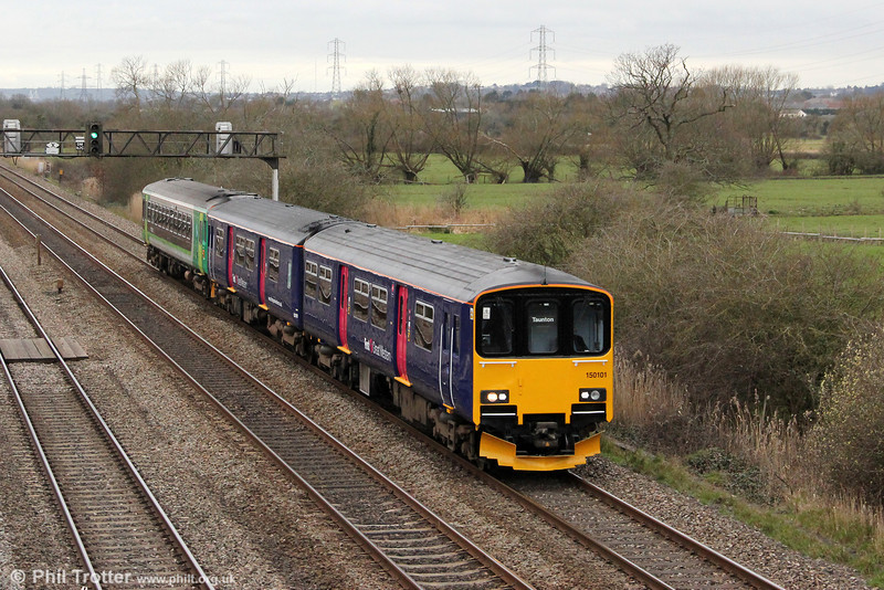 FGW 150101 leads on-hire London Midland 153325 through Coedkernew forming 2C85, 1700 Cardiff Central to Taunton on 20th March 2012.