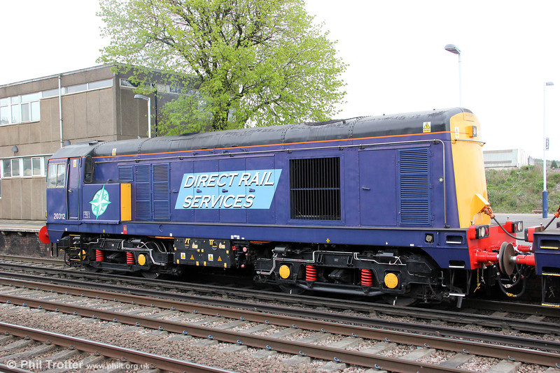A study of DRS 20312 at Eastleigh on 5th May 2012, while working Pathfinder's 1Z61, 0623 Crewe to Eastleigh Works, 'The Hampshire Hotchpotch'. The loco was new as no. D8042, being renumbered 20042 under TOPS; DRS maintains a fleet of 15 similar class 20/3 locomotives, which were rebuilt with the later style multiple working equipment between 1995 and 1998.