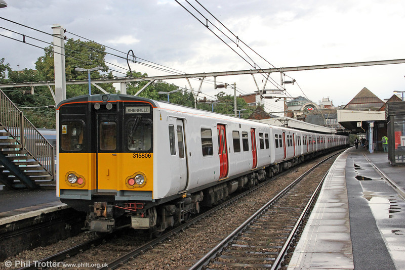 Refurbished GA 315806 calls at Ilford at the rear of 2W42, 1720 London Liverpool Street to Shenfield on 25th August 2012.