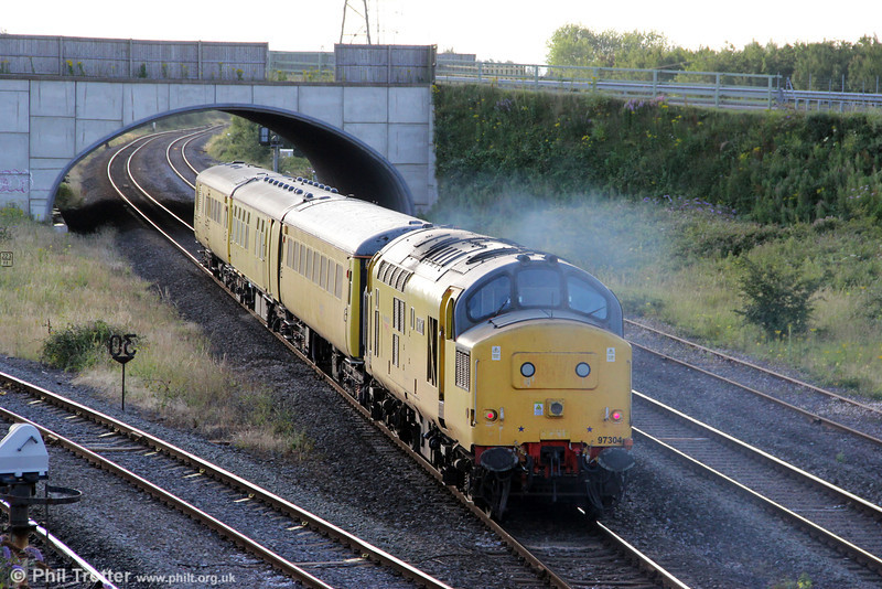NR 97304 (37217) 'John Tiley' leaves an exhaust trail as it propels Test Train 3Z33, 0515 Milford Haven to Derby RTC through Llandeilo Junction on 28th July 2012.