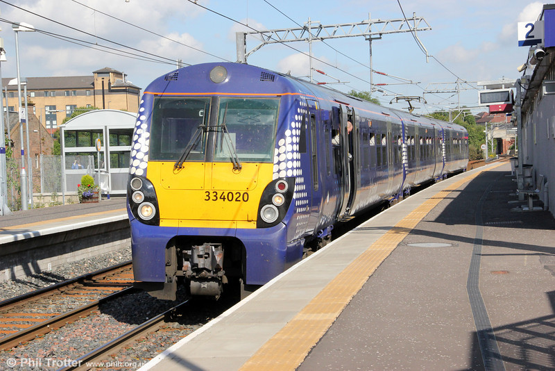 Reliveried 334020 waits time at Airdrie while working 2H53, 1521 Edinburgh Waverley to Helensburgh on 4th August 2012.