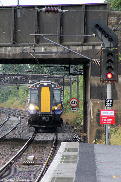 380107 is seen approaching Kilwinning forming 1K66, 1513 Ayr to Glasgow Central on 5th August 2012.