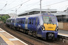 334012 calls at Partick forming 2H80, 0855 Helensburgh to Edinburgh Waverley via Airdrie and Bathgate on 5th August 2012.