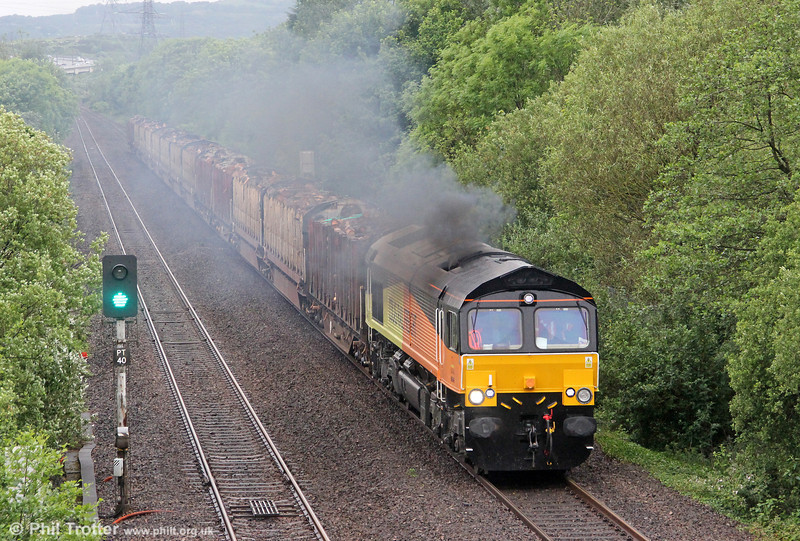 Something is clearly not as it should be with Colas Rail's 66846 (the former Freightliner 66573) as it accelerates through Baglan with 6Z51, 1600 Baglan Bay to Chirk (Kronospan) loaded timber on 5th June 2012.