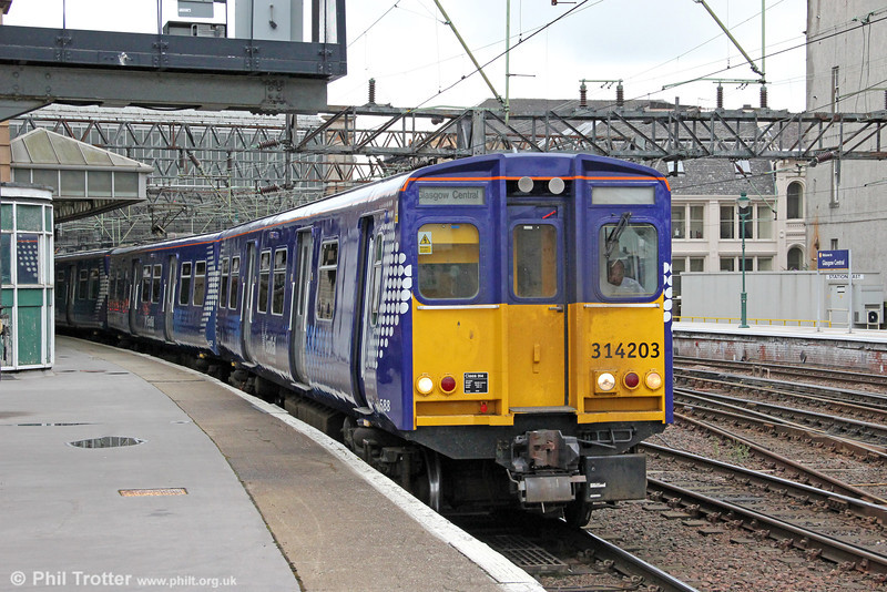 Scotrail has a fleet of just 16 class 314s dating from 1979 and which are used on Glasgow inner suburban services. The initial plan was that only five of the class would receive the new Saltire livery. One of them is 314203, seen here leaving Glasgow Central forming 2N18, 0839 to Neilston on 6th August 2012.