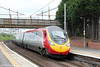 VWC Pendolino 390122 'Beth Tweddle MBE' heads through Motherwell forming 1M12, Glasgow Central to London Euston on 5th August 2012.