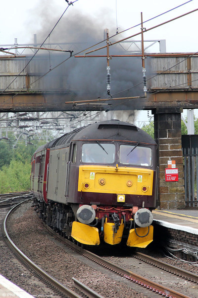 The driver of WCRC 47760 opens up as he catches sight of a clear signal at Motherwell on 5th August 2012. The working is 5Z54, 1040 Perth to Carnforth with the ECS of the previous day's railtour to Fort William.