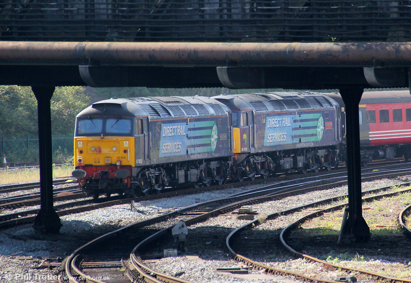 Framed by the pillars of the Bath Road overbridge, 47802 'Pride of Cumbria' and 47810 'Peter Bath MBE' bring up the rear of 5Z73, 1004 Cardiff Pengam to Bristol West 'The Africa Express' ECS at Bristol TM on 8th September 2012.