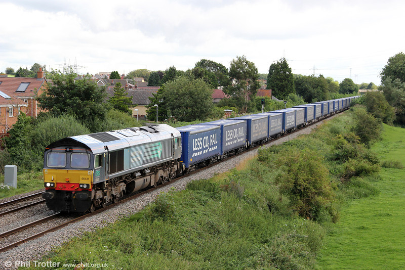 DRS 66431 passes Portskewett with 4V38, 0822 Daventry to Wentloog 'Tesco Express' on 20th August 2012.