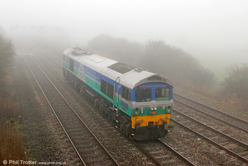 59001 'Yeoman Endeavour' in the fog at Coedkernew running as 0V59, 0945 Cardiff Canton to Westbury on 1st March 2012. The loco had been to Canton for tyre turning.