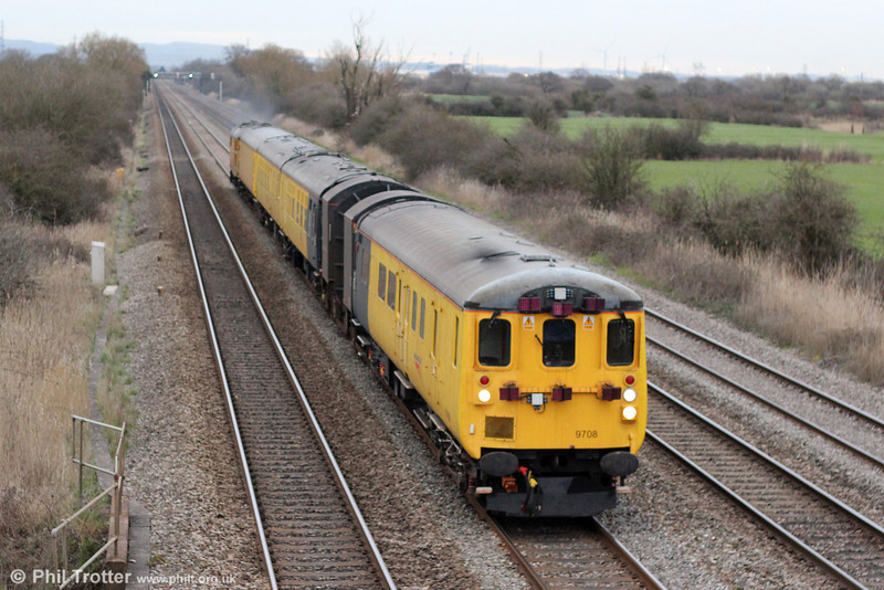 With the light now failing, NR DBSO 9708 leads the structure gauging train 1Q06, 0903 Hither Green to Landore TMD through Coedkernew on 20th March 2012. Power was provided by 31285 at the rear.