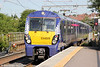 334028  is senn arriving at a sunny Airdrie while working 2M33, 1538 Edinburgh Waverley to Milngavie on 4th August 2012.