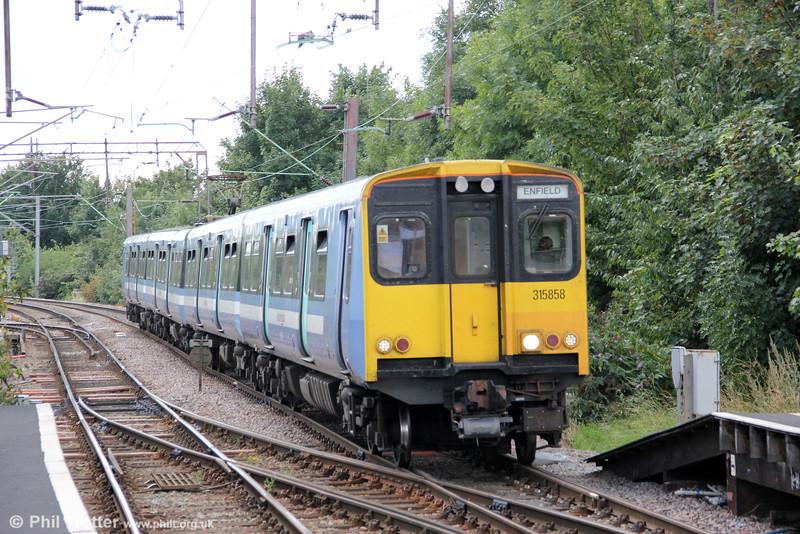 315858 is seen at Seven Sisters forming 2U38, 1207 London Liverpool Street to Enfield on 26th August 2012.