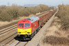 Looking spotless in the sunshine, 60063 passes Coedkernew with 6H26, 1331 Llanwern to Margam on 10th March 2012.