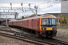 Royal Mail Class 325 no. 325011 departs from Crewe forming 5J00, 1242 Crewe TMD to Warrington Royal Mail Terminal on 7th November 2012.