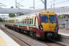 334035 calls at the new Drumgelloch station forming 2M22, 1357 Milngavie to Edinburgh Waverley on 4th August 2012.