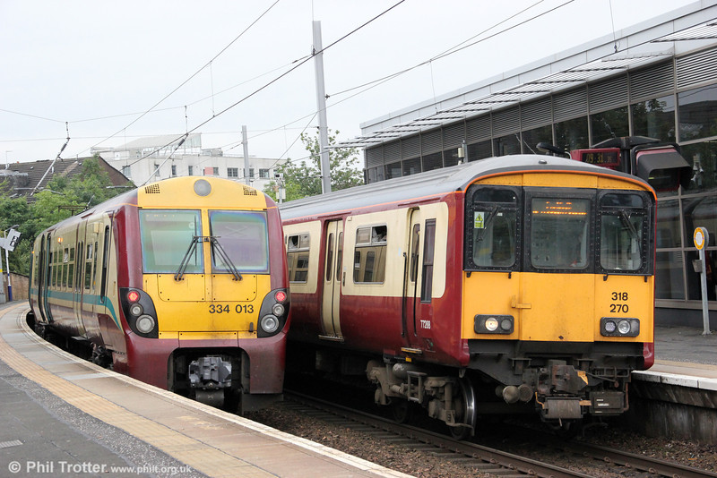 318270 meets 334013 at Partick on 5th August 2012. 318270 is forming 2L08, 0936 to Larkhall (arrived as 5L08 from Yoker), while 318270 is 2H05, 0858 Airdrie to Helensburgh.