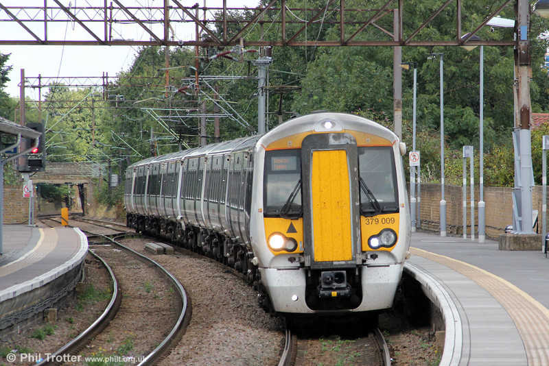 379009 calls at Seven Sisters forming 1B47, 1130 Stanstead Airport to London Liverpool Street 'Stanstead Express' on 26th August 2012.
