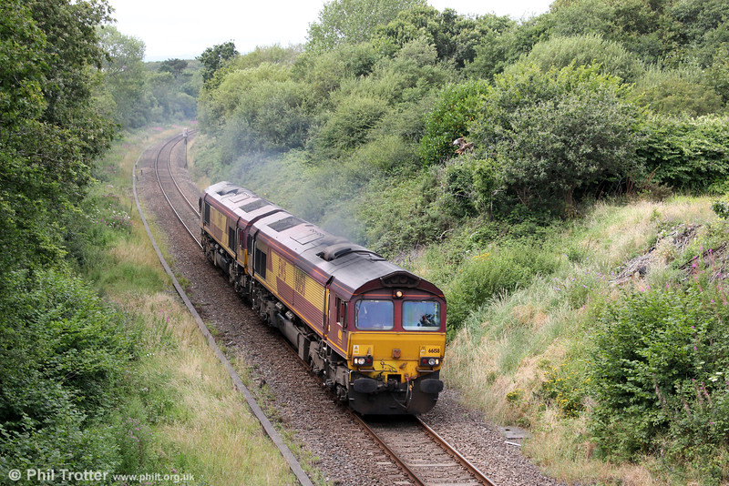 66158 and 66230 return light to Margam through Waunarlwydd after hauling 6Z42 to Trostre on 12th August 2012.