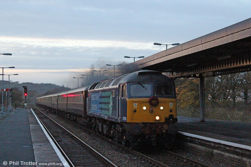 In failing light, 47828 passes Whitland with the late running 1Z35, 1523 Fishguard Harbour to Cardiff Central, the return Northern Belle dining train on 11th November 2012.