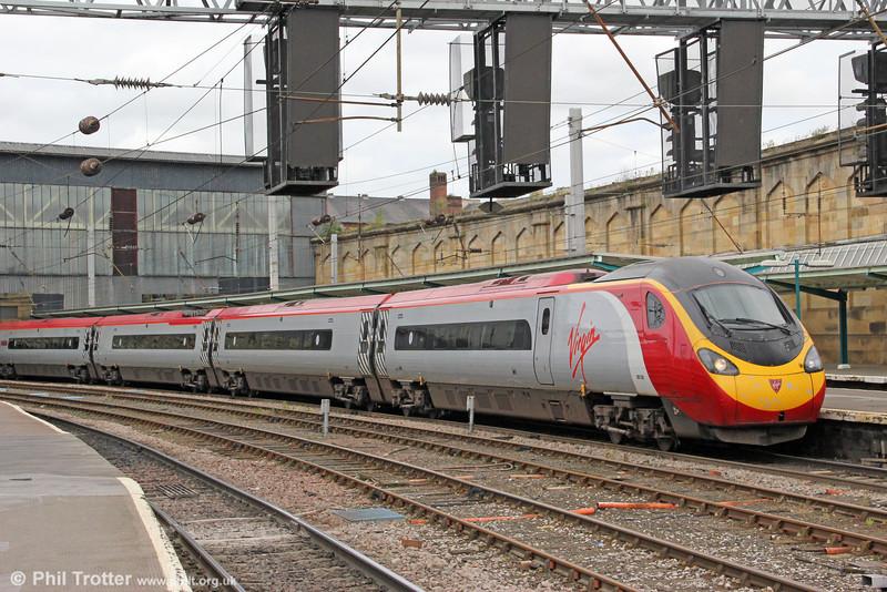 VWC Pendolino 390038 'City of London' calls at Carlisle forming 1M54, 1051 Edinburgh Waverley to London Euston on 7th August 2012.