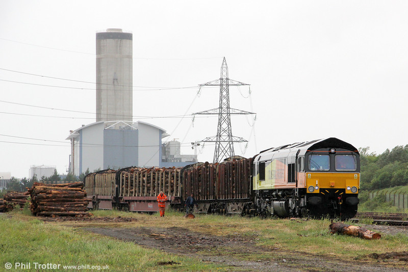 Baglan Bay Power Station forms a backdrop to Colas Rail's 66846 ready to depart from Baglan Bay loading point with another load of timber, 6Z51, 1600 to Chirk (Kronospan) on 5th June 2012.