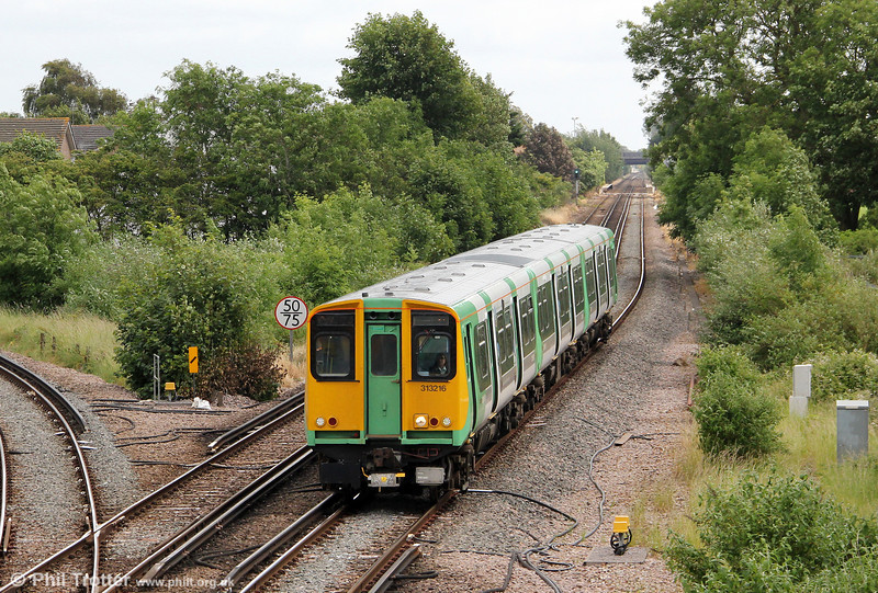 The 20 vintage class 313s inherited by Southern are employed on 'Coastway' services based on Brighton. Built by BREL in 1976-1977, these units are now the oldest EMUs in regular service on the UK's mainland rail network. Those operated by Southern were displaced from London Overground in 2010 by new class 378s. Here, 313216 is seen at Havant Junction forming 2N63, 1154 Littlehampton to Portsmouth & Southsea on 23rd June 2012.