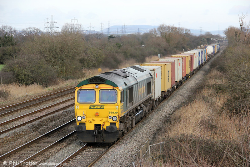 66539 passes Coedkernew with 4V52, 1000 Southampton to Wentloog on 28th January 2012.