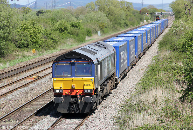 DRS 66302 in full sun at Coedkernew with 4V38, 0822 Daventry to Wentloog 'Tesco Express' on 8th May 2012.