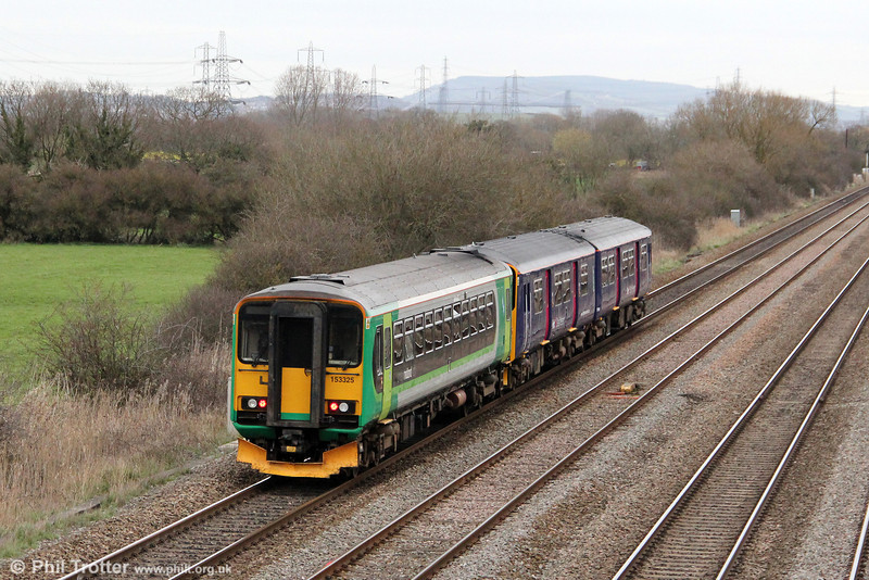 On-hire London Midland 153325 brings up the rear of 2C85, 1700 Cardiff Central to Taunton at Coedkernew on 20th March 2012.