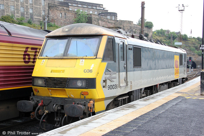 Still sporting a BR logo, 90036 is seen at rest at Edinburgh Waverley on 6th August 2012.