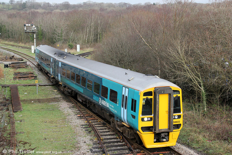 158822 returns through Tondu forming the 1315 Maesteg to Cardiff Central on 14th January 2012.