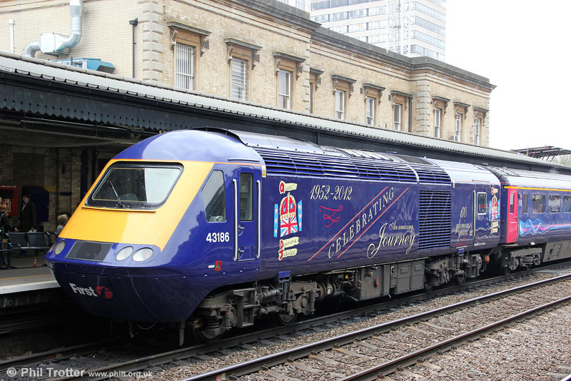 By Royal Appointment: FGW's 43186 now carries a commemorative livery for the Queen's Diamond Jubilee which was applied at Laira. The decorated power car is seen at Reading on 19th May 2012, bringing up the rear of 1C80, 1035 London Paddington to Newquay. It is perhaps worth noting that the HSTs have been a significant feature of the British - and Australian (XPT) - railway scene for well over half of Her Majesty's reign!