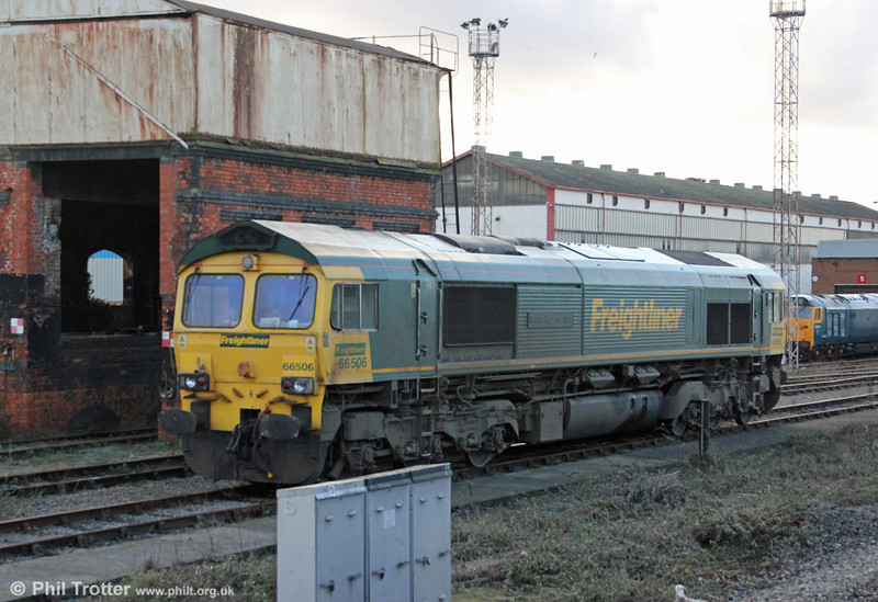 66506 'Crewe Regeneration' is glimpsed stabled at Cardiff Canton on 18th February 2012.