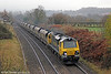 70010 heads through Penpergwm with 6Z61, 0725 Portbury to Fiddlers Ferry Power Station on 24th November 2012.