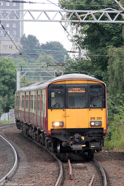 Refurbishment of Scotrail's 21 class 318 units which involved the removal of the corridor connection on the driving cars has not improved their appearance. Here, 318251 approaches Partick forming 2F59, 0910 Motherwell to Balloch on 5th August 2012.